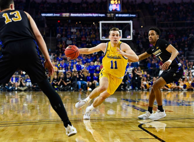 SDSU's Noah Freidel drives past Purdue Fort Wayne's Matt Holba and Jarred Godfrey during the Summit League tournament quarterfinals on Saturday night, March 7, at the Denny Sanford Premier Center in Sioux Falls.