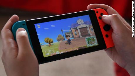 """Pictured here: Someone playing Nintendo's """"Animal Crossing"""" at home during the Covid-19 coronavirus lockdown."""
