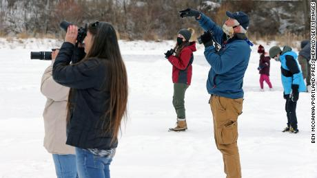 Birdwatchers pictured here on the frozen Capisic Pond.