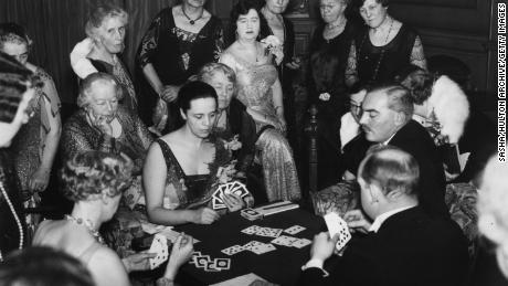 Four people, pictured here on November 29, 1930, playing Bridge.