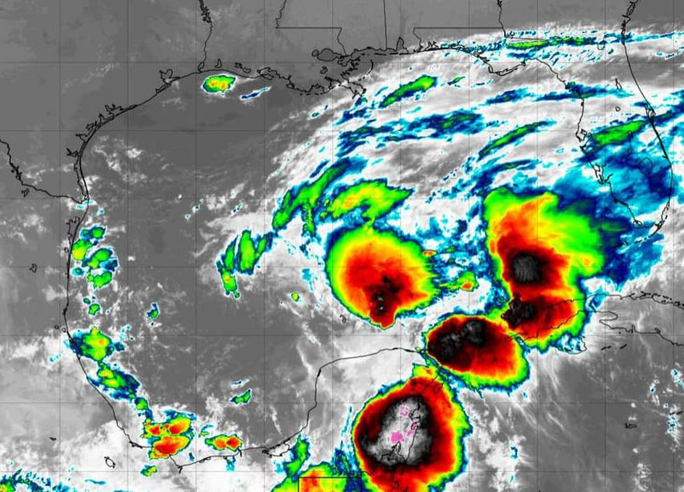 Invest 92L is consolidating this morning but it remains in a high shear, lots of dry air...